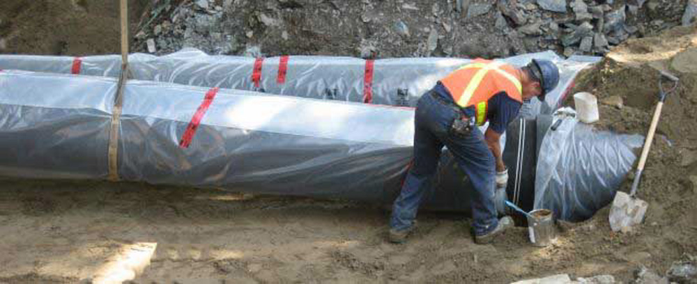 Photo of encased ductile iron pipe installation