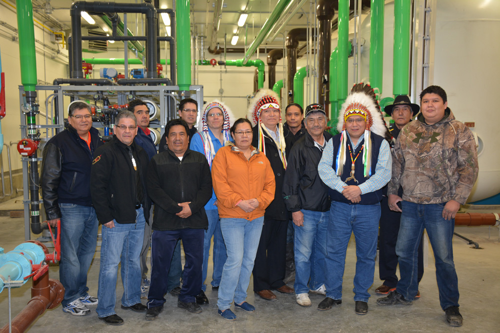 Chiefs and band members inside plant