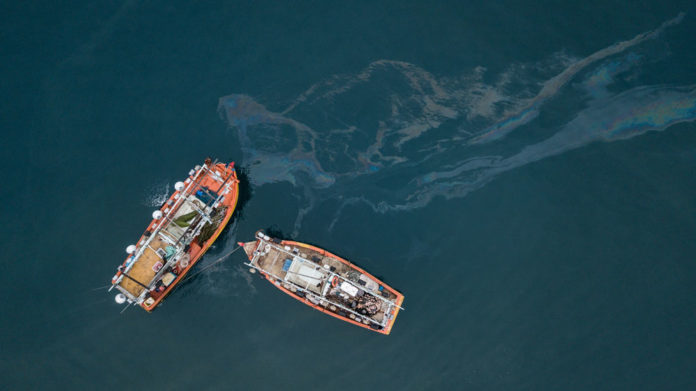 ships with oil sheen on the water